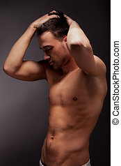 young handsome muscular man - young muscular man with a bare...