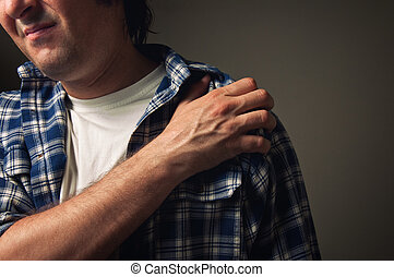 Shoulder pain - Young adult man suffering from severe...