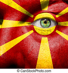 Flag painted on face with green eye to show Macedonia support