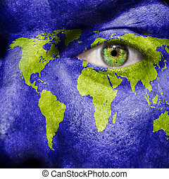 World map painted on face to show world support and...