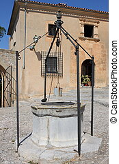 Medieval water well in Saint Salvador church in Arta, Spain