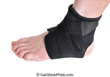 Black Ankle Brace - Foot Wrapped in a Black Ankle Brace...