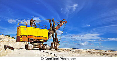 Heavy excavator in quarry for the extraction of gravel....