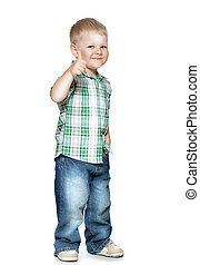 Portrait of beautiful little boy giving you thumbs up over...
