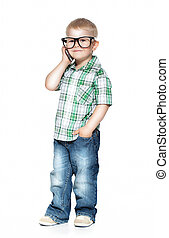 a little boy with glasses talking on the phone. isolated on white