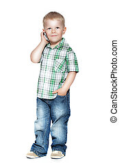 a little boy talking on the phone. isolated on white