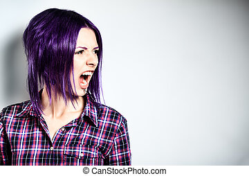 aggression - Portrait of a aggressive punk girl with purple...