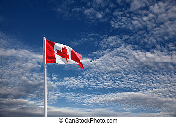 canadian flag against blue sky