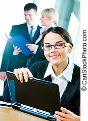 Attractive office worker - Young attractive office worker is...