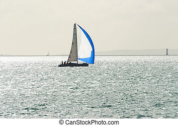 single yacht sailing - Yacht sailing with blue and white...