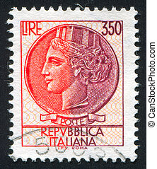 woman who symbolize Italy - ITALY - CIRCA 1977: stamp...