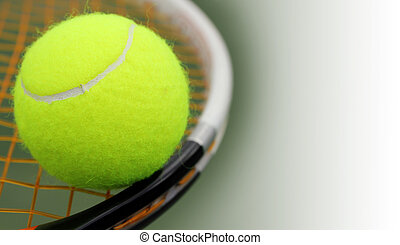 New tennis ball on a new racket with orange stringgut and...