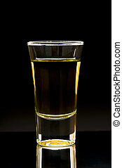 shot - whiskey or tequila shot on a dark background