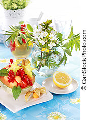 Summer refreshment with dessert fruit and lemonade