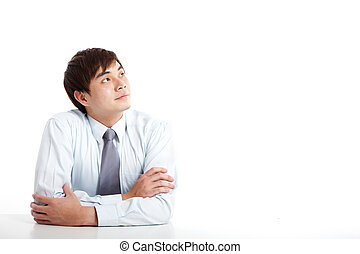 asian young businessman looking up