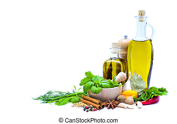 olive oil, herbs and spices isolated on a white background...