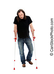 Disabled man walking on crutches - Disabled middle-aged man...