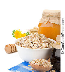 cereals with honey and oatmeal isolated on white - grain...