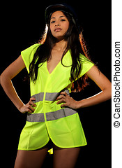 Sexy woman with safety jacket and helmet
