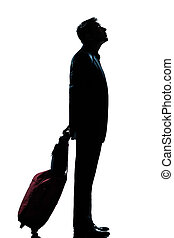 silhouette man business traveler waiting looking up