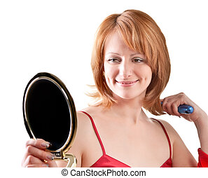 woman looking into a mirror - beautiful adult woman looking...