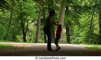 Mum playing with  son in the park