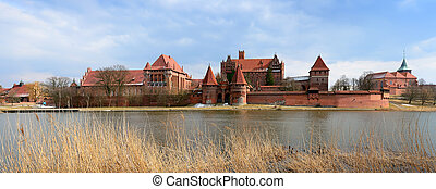 malbork caste in poland - panorama with medieval castle in...
