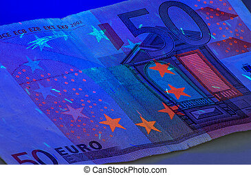 Fifty Euro under ultraviolet light