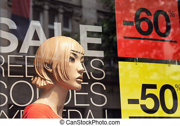 Discount signs in a shop window - 50 and 60 discount on...