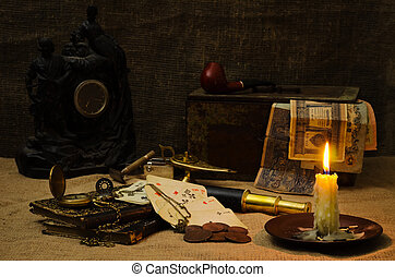 Still life in candle light with old things
