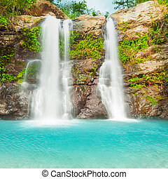 Beautiful waterfall in tropical rainforest