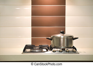 Saucepan - Modern kitchen / Saucepan on an oven