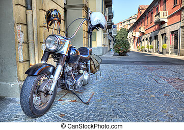 Motorcycle on the street Alba, Italy - Harley Davidson type...