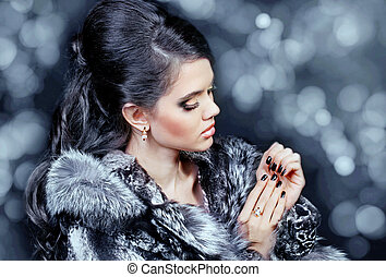 Fashion woman in fur coat