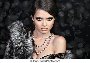 Photo of sexual beautiful girl is in fashion style, fur coat