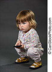 Cute little baby with fathers mobile phone, smartphone