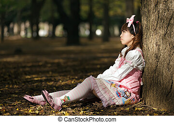 lolita depression - sad japanese lolita leaning against tree...