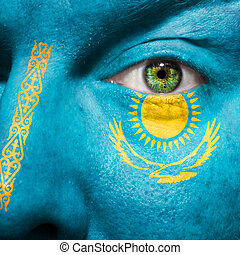 Flag painted on face with green eye to show Kazakhstan...