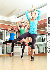 yoga class - Group of young women in the gym centre Pilates...