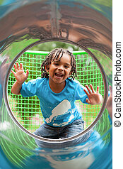 Portrait of a cute african little boy at playground