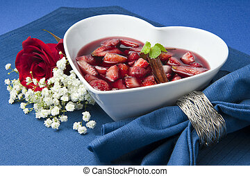 strawberries with red wine, cinnamon and brown sugar on a...