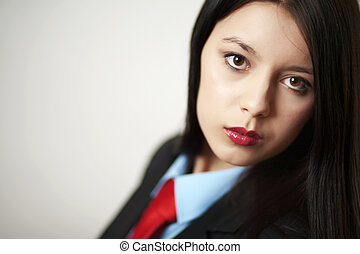 business woman - young woman dressed up in a man suit and...