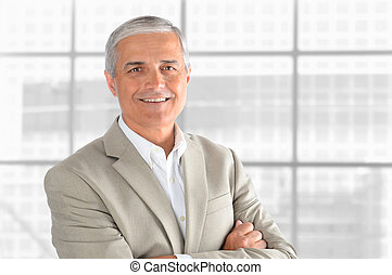 Mature Businessman in front of window - Portrait of a middle...