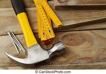 Woodworking tools - Nails, hammer and folding ruler on wood