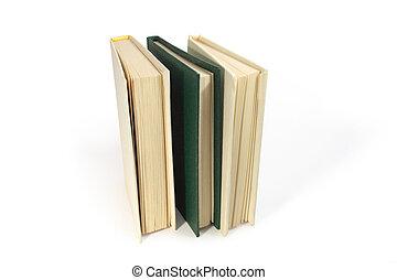 Three books - Three hardcover books standing on white...
