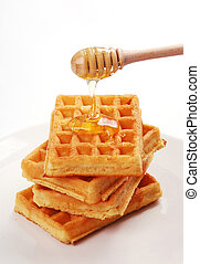 freshly baked waffles with honey