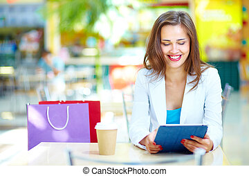 Shopping leisure - Shopping girl laughing looking at the...