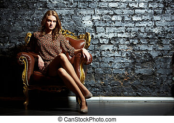 Contrast - Gorgeous girl sitting in a vintage chair...