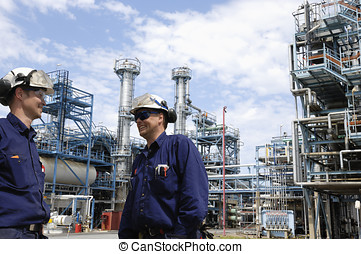 oil workers inside chemical plant - two oil and gas workers...