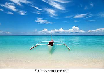 White boat on a tropical beach in Philippines